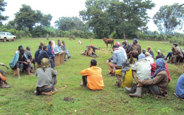 Community members discuss land use planning, COMDEKS Ethiopia
