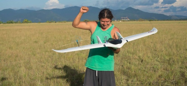 Figure 3: A member of the Wapichan land and forest monitoring team piloting the use of an unmanned aerial vehicle (UAV) to monitor land use change in remote areas of the Wapichan territory. (Photo by Digital Democracy – Gregor MacLennan)