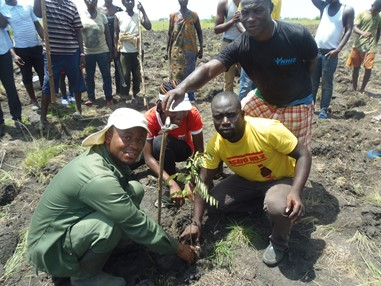 Photo 5: Wildlife Officer with local warrior representative during a tree planting exercise Photo credit: A Rocha Ghana, 2015